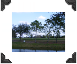 golf driving range pond in forground