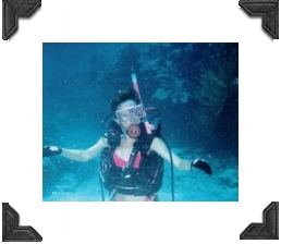 woman underwater in scuba gear