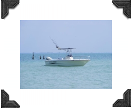 boat anchored offshore, fishing rods aboard