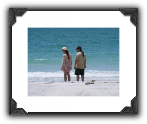 man and woman walking on florida beach, egmont key